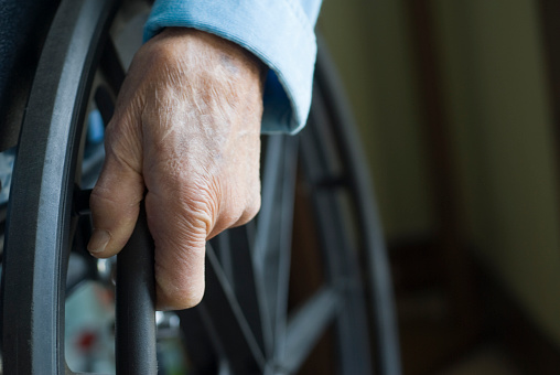 Senior Hand On Wheelchair Wheel Stock Photo - Download Image Now