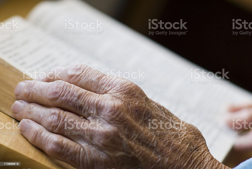 Senior hand with book in background royalty-free stock photo