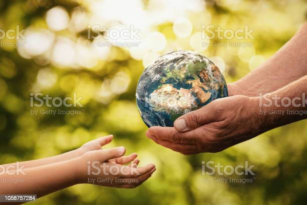 Senior hands giving small planet earth to a child picture id1058757284?b=1&k=6&m=1058757284&s=612x612&h=9s tzuwn5oja 2myltprqnad6 opsc0bofbbo5zadoo=