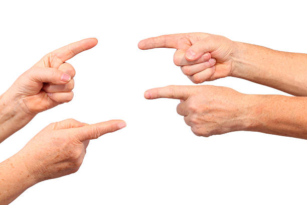 Senior hands show forefinger gesture stock photo