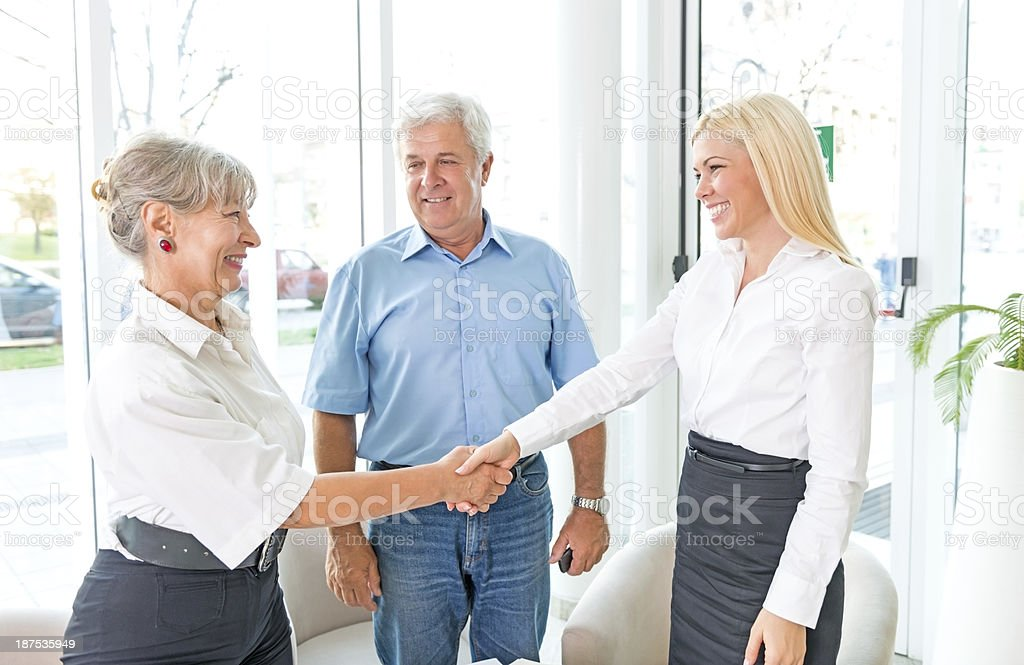 Senior Happy Couple Shaking Hand With Insurance Agent royalty-free stock photo