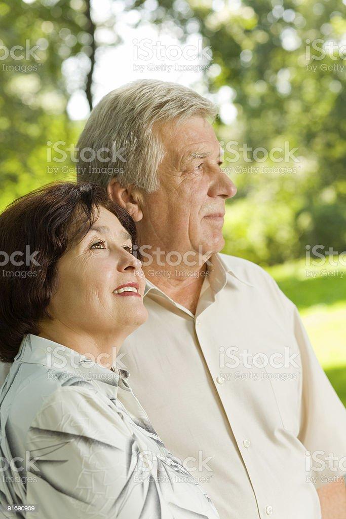 Senior happy couple walking together outdoors royalty-free stock photo
