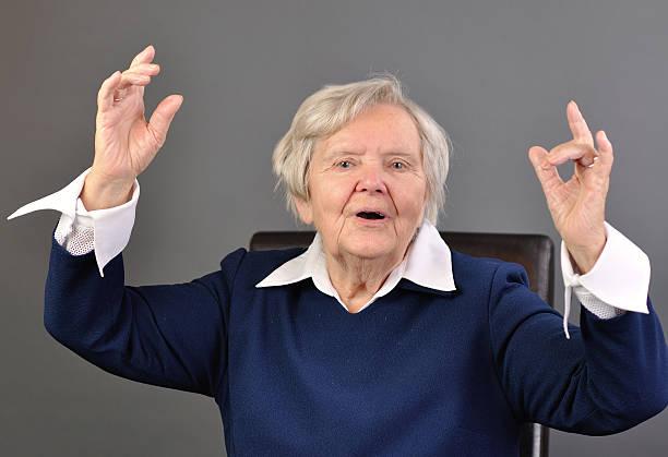 Senior happy woman with grey hairs stock photo