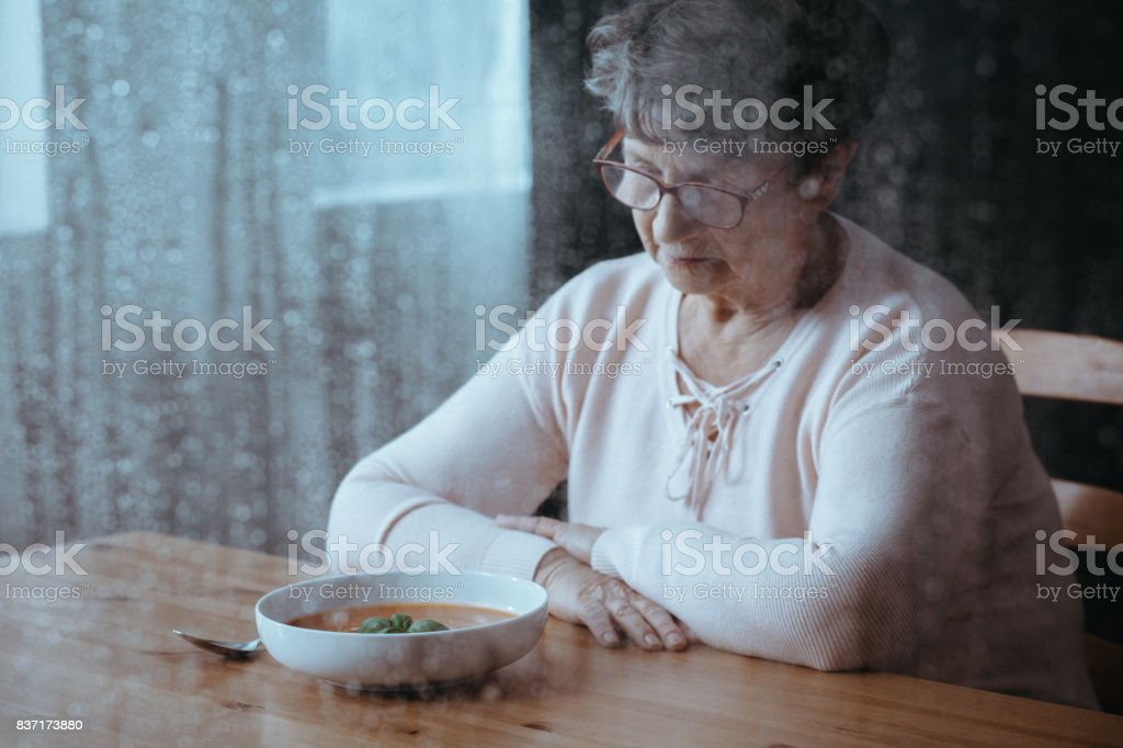 Senior having lack of appetite stock photo