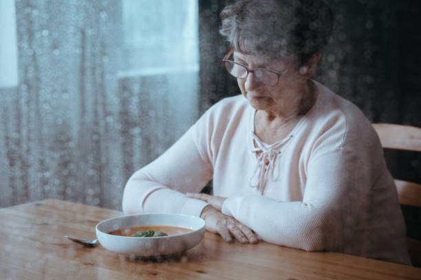 Senior having lack of appetite Sad, senior woman having lack of appetite hungry stock pictures, royalty-free photos & images