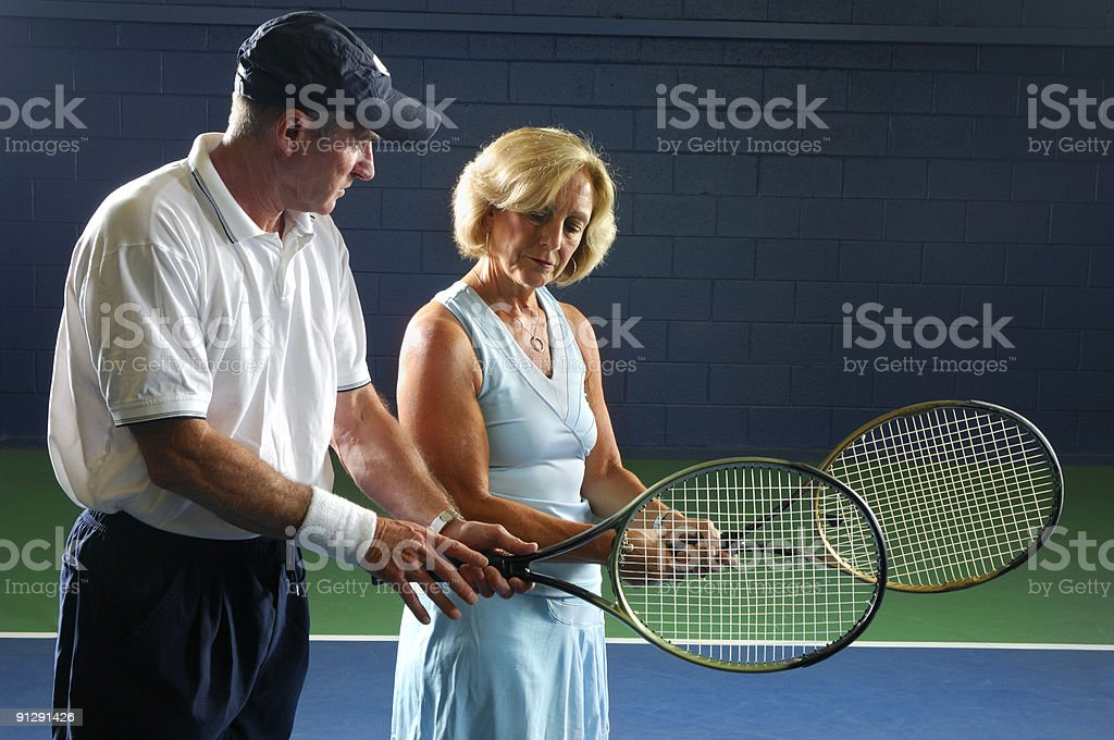 Senior Health and Fitness Tennis Instruction Gripping royalty-free stock photo