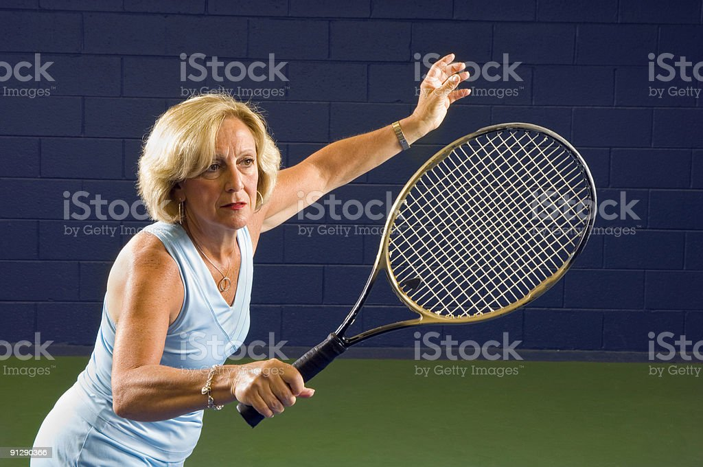 Senior Health and Fitness Tennis Volley royalty-free stock photo