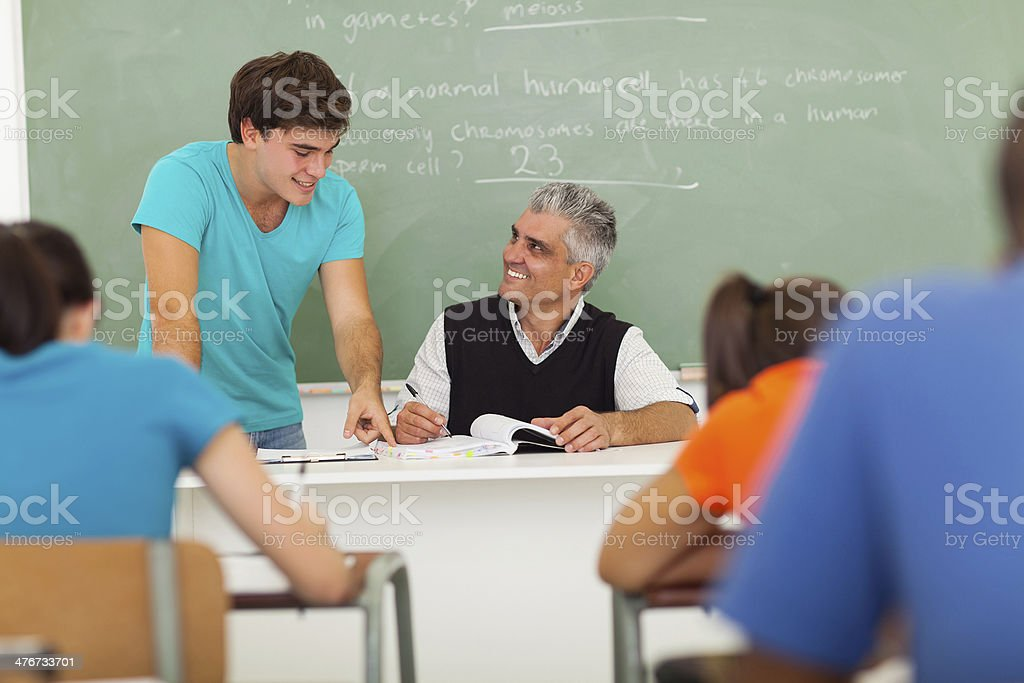 senior high school educator helping student royalty-free stock photo
