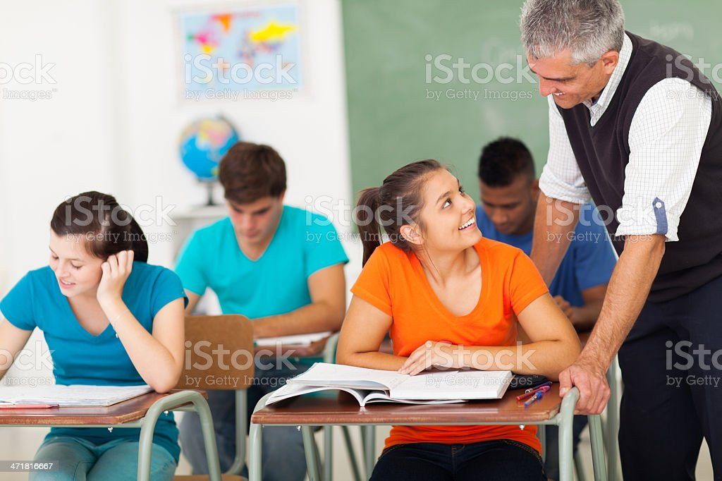 senior high school teacher talking to student royalty-free stock photo