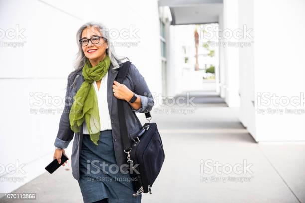 Senior hispanic businesswoman walking down hallway picture id1070113866?b=1&k=6&m=1070113866&s=612x612&h=eg vwcr4ra ctikqgvpwyq6h12vflhlzdgq chxebcg=