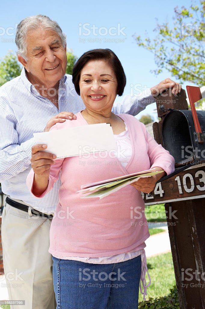 Senior Hispanic Couple Checking Mailbox royalty-free stock photo