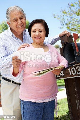 istock Senior Hispanic Couple Checking Mailbox 168337295