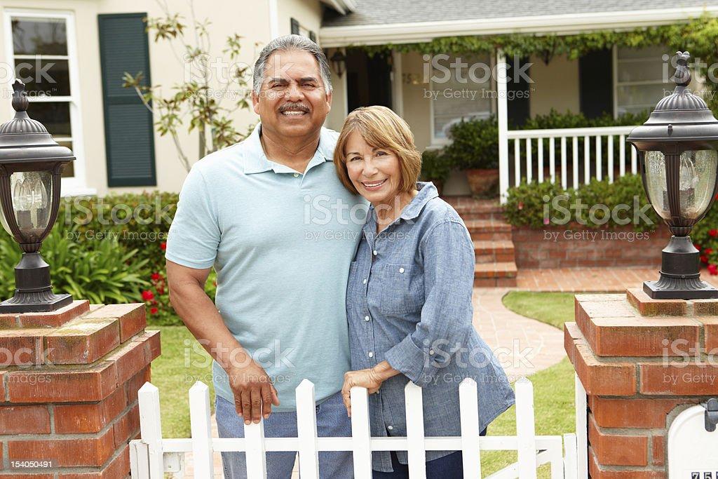 Senior Hispanic couple outside home stock photo