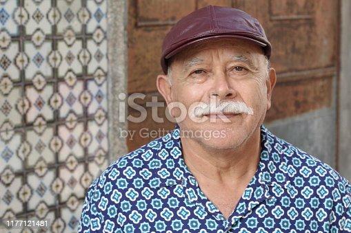 Senior Hispanic man close up.
