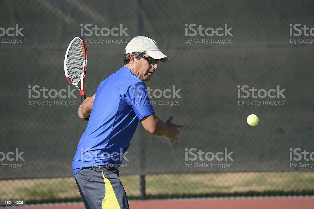 Senior Hispanic Playing Tennis royalty-free stock photo