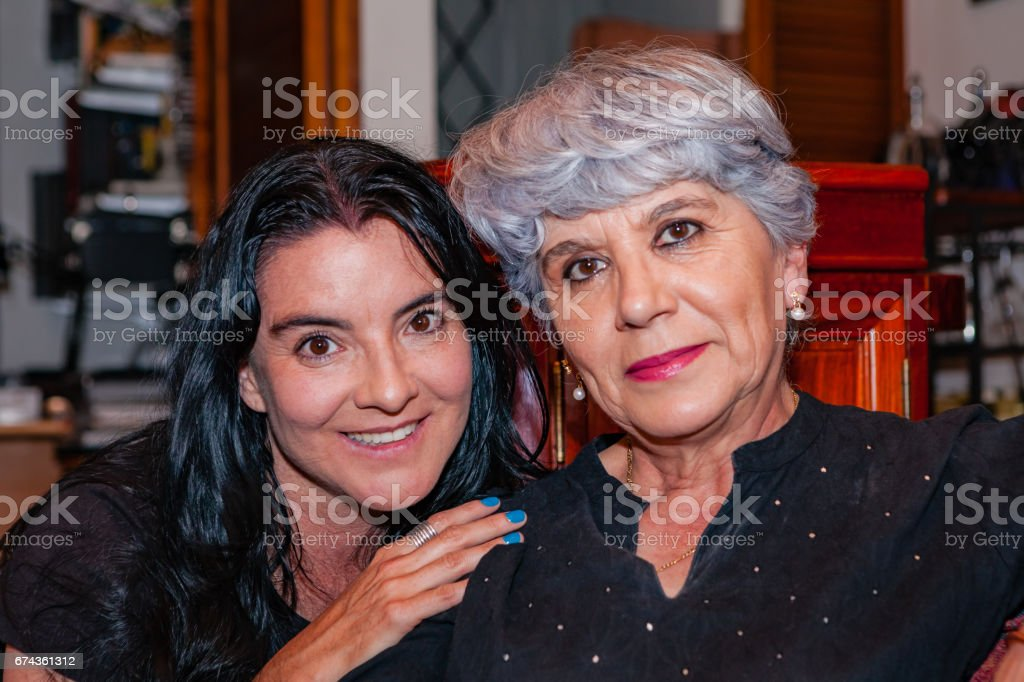 A Senior Hispanic Silver Haired Lady and Her Niece. A Moment of Latin Togetherness. stock photo
