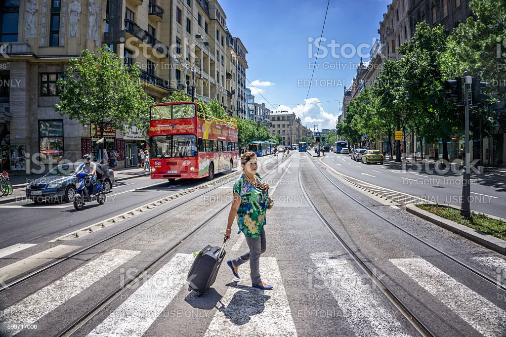 Senior hispanic tourist crossing street in central Budapest stock photo
