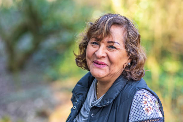 Senior Hispanic woman portrait in countryside Senior Hispanic woman portrait in Welsh countryside 65 69 years stock pictures, royalty-free photos & images
