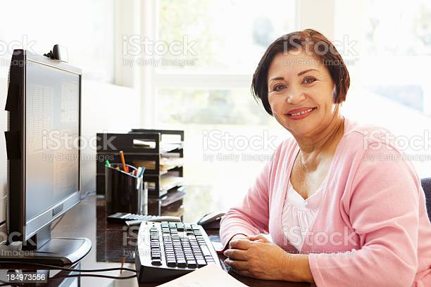 Senior hispanic woman working on computer at home picture id184973556?b=1&k=6&m=184973556&s=612x612&h=nhwjastlaixfj2i31tzswaxcnegg65czigrmav7rn08=