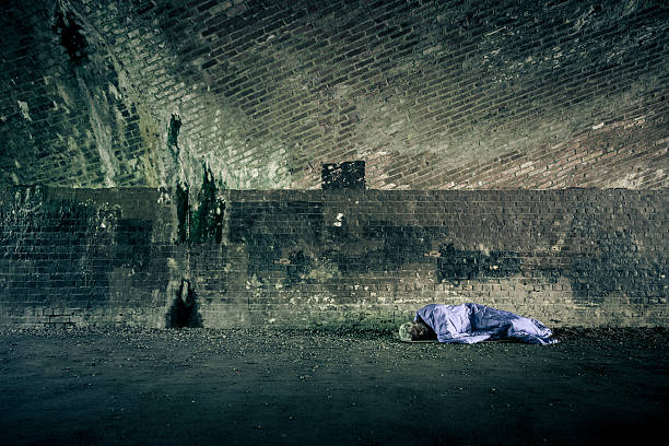 senior homeless caucasian male sleeping rough outdoors - homelessness stock photos and pictures