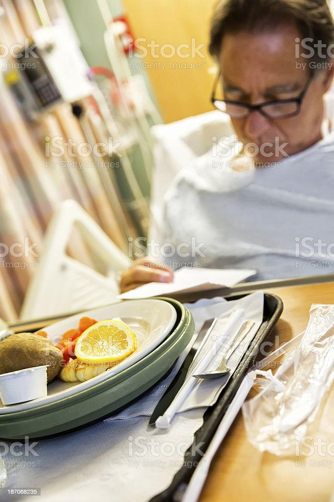 Senior hospital looks at the dinner menu royalty-free stock photo