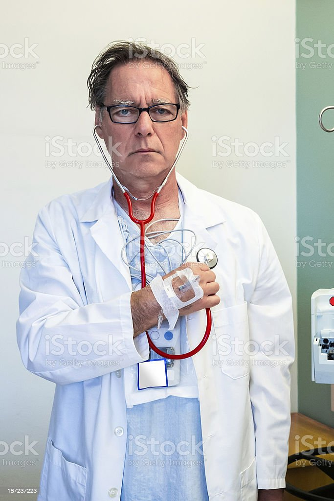 Senior hospital patient advocates as his own doctor royalty-free stock photo