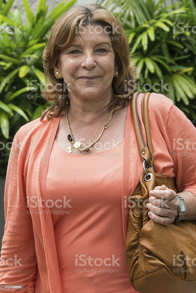 Senior housewife Smiling sixty something caucasian woman posing looking at the camera 55-59 Years Stock Photo