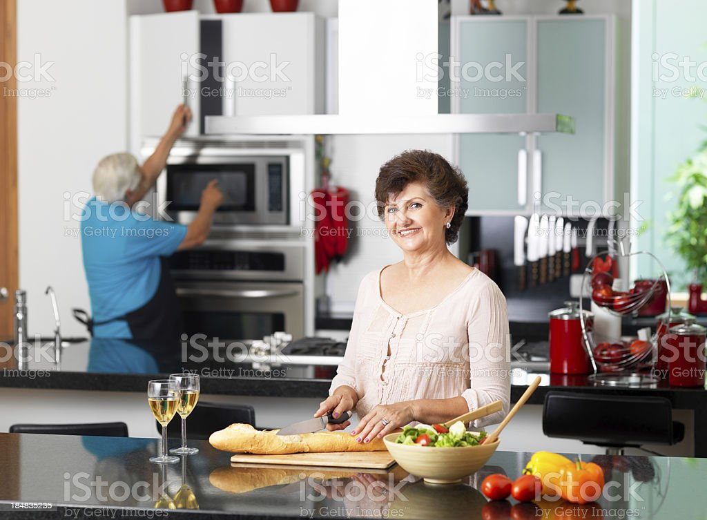 Senior husband and wife making some dinner royalty-free stock photo