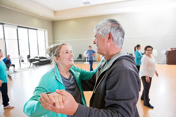Senior husband and wife take dance lessons stock photo