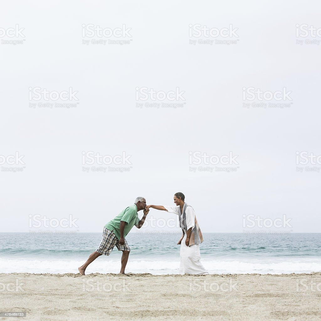 Senior husband kissing his wife's hand royalty-free stock photo