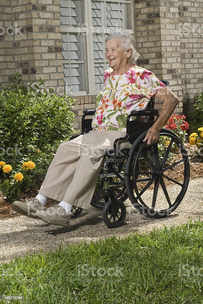 Senior in a wheelchair royalty-free stock photo