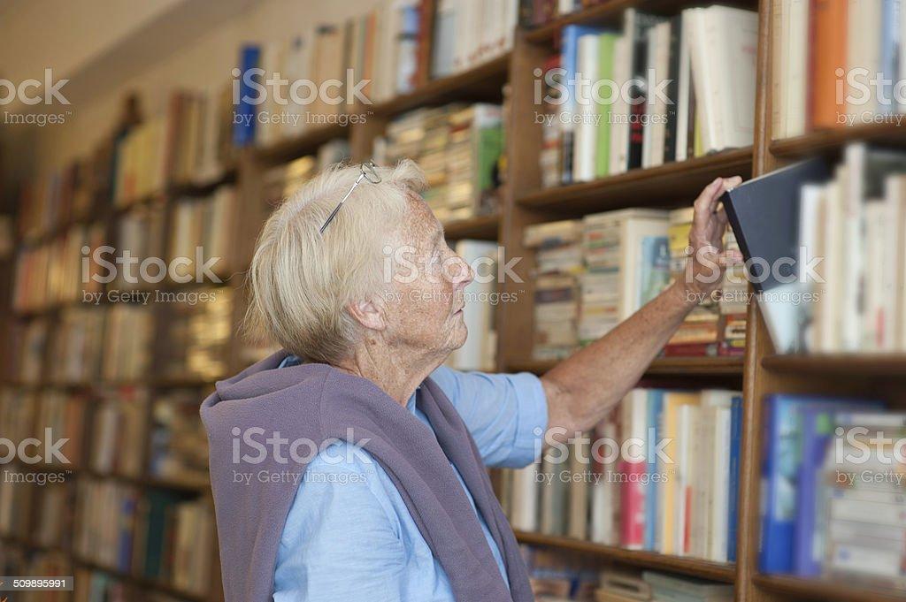 Senior in bookstore stock photo