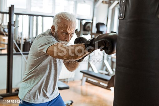 Senior in gym boxing