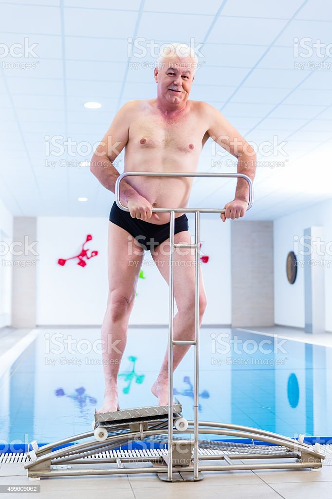 Senior in water gymnastics therapy stock photo
