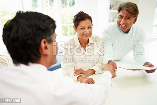1160751010 istock photo Senior Indian Couple Meeting With Financial Advisor At Home 456621285