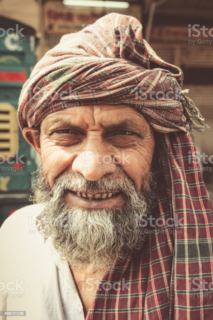 Senior indian man in the streets of New Delhi. Real People Portrait....