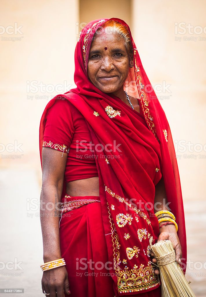 Senior Indian Woman Dressed in Traditional Attire Cleaning stock photo
