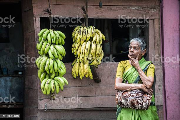 Senior indian woman selling bananas at roadside in rural india picture id521996135?b=1&k=6&m=521996135&s=612x612&h=6dgwq spigz3wv5p58tc cln 9x9wtuxwgywntrewry=