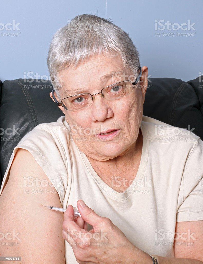 Senior injection royalty-free stock photo