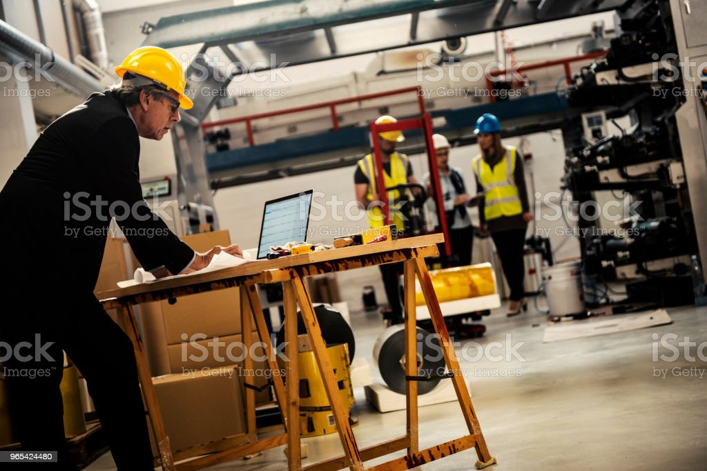 Senior inspector checking production line royalty-free stock photo