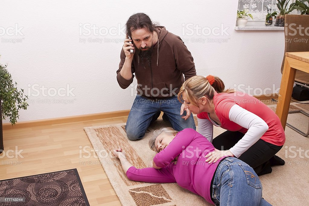 senior is unconscious, childs calling  rescue service stock photo