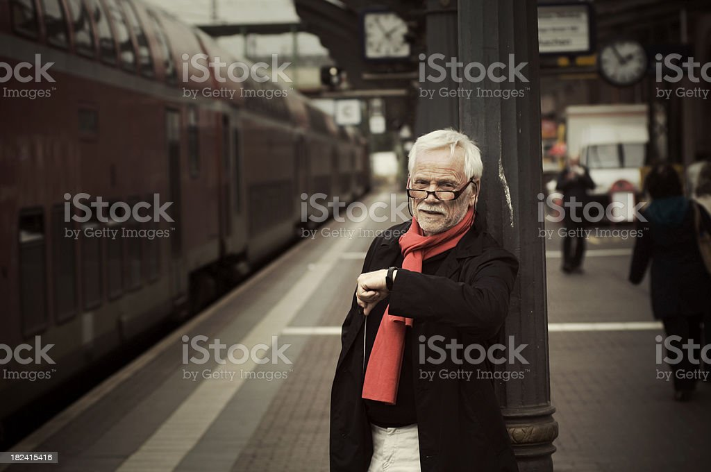 Senior is waiting for the train royalty-free stock photo