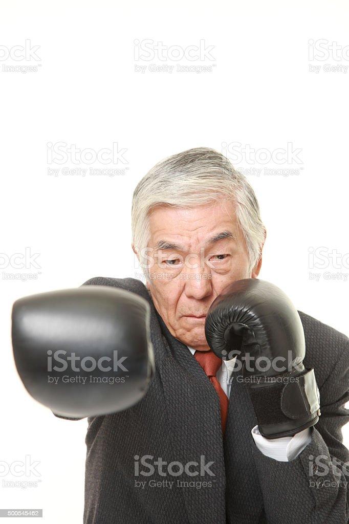 senior Japanese businessman throws a right straight stock photo
