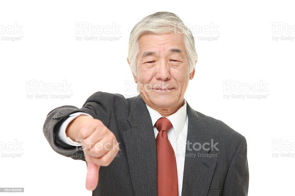 senior Japanese businessman with thumbs down gesture stock photo