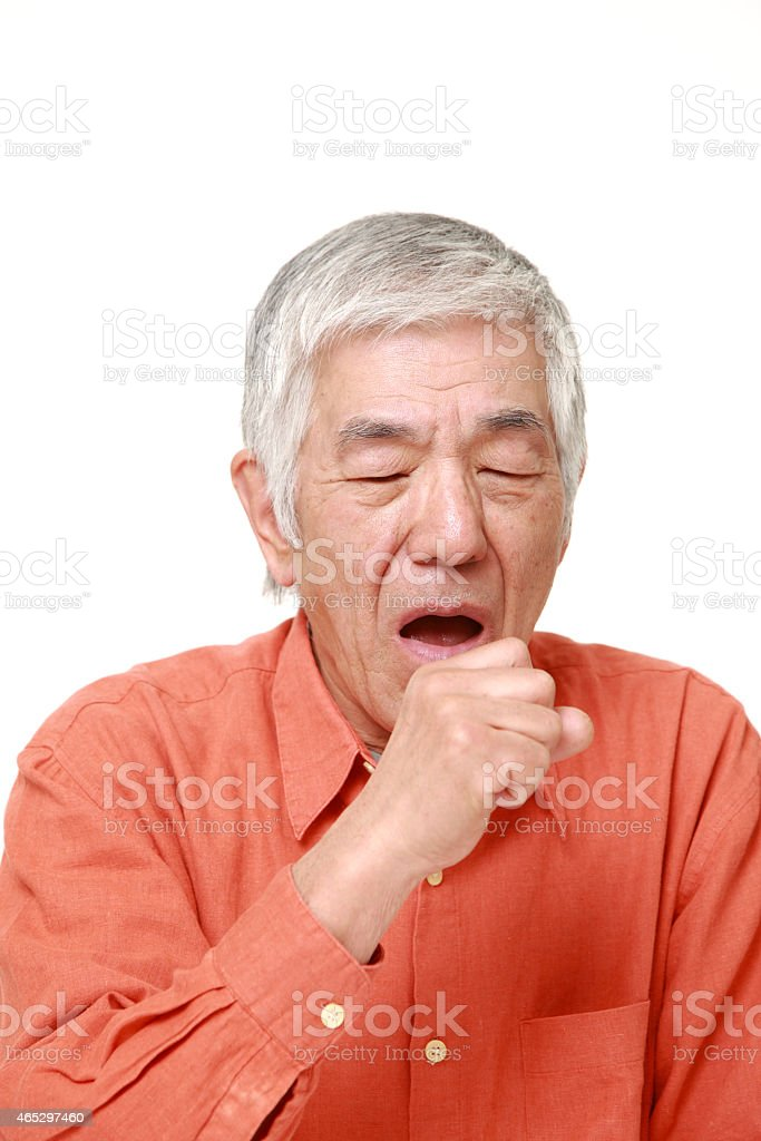 senior Japanese man coughing stock photo