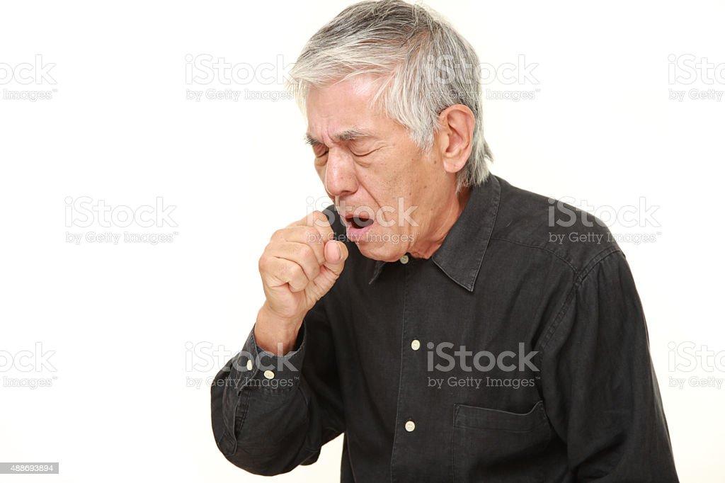 senior Japanese man coughing stock photo
