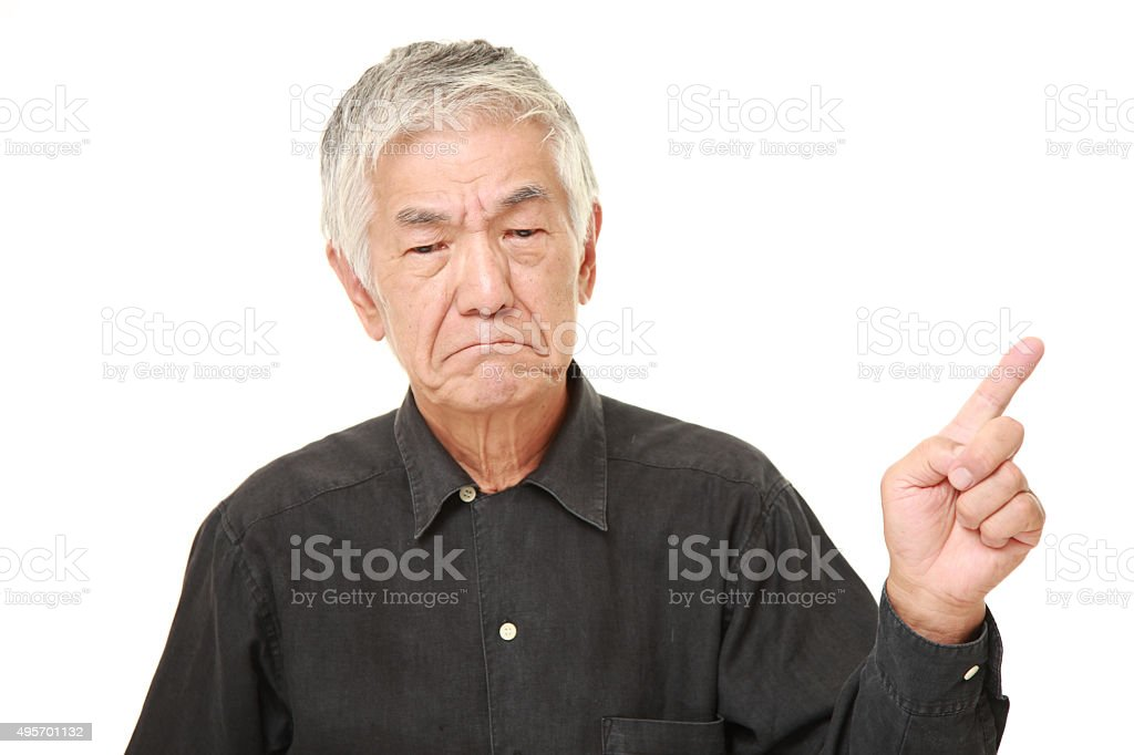 senior Japanese man doubting stock photo