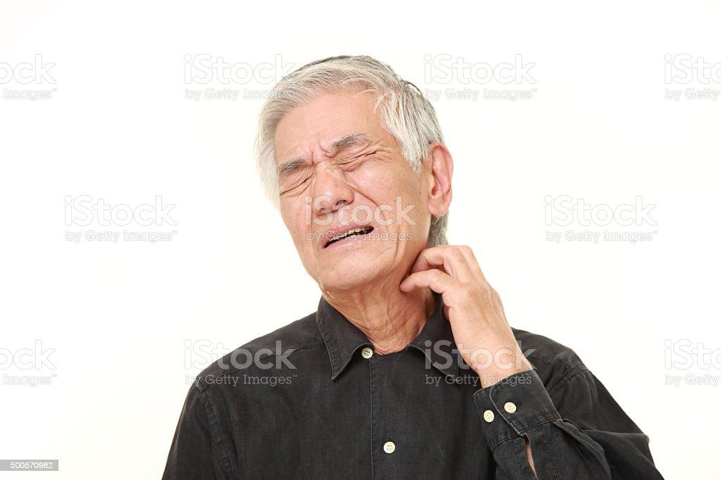senior Japanese man scratching his neck stock photo