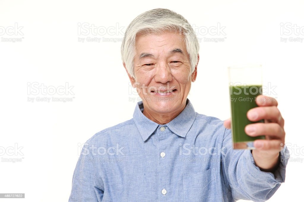 senior Japanese man with green vegetable juice stock photo