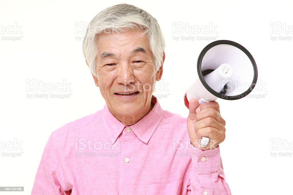 senior Japanese man with megaphone stock photo